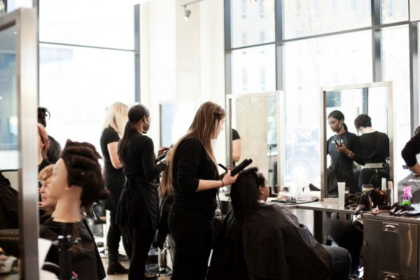 Group of Jean Madeline Aveda Institute students practicing in salon
