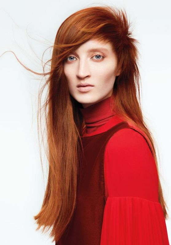 aveda model with long red hair and pale makeup