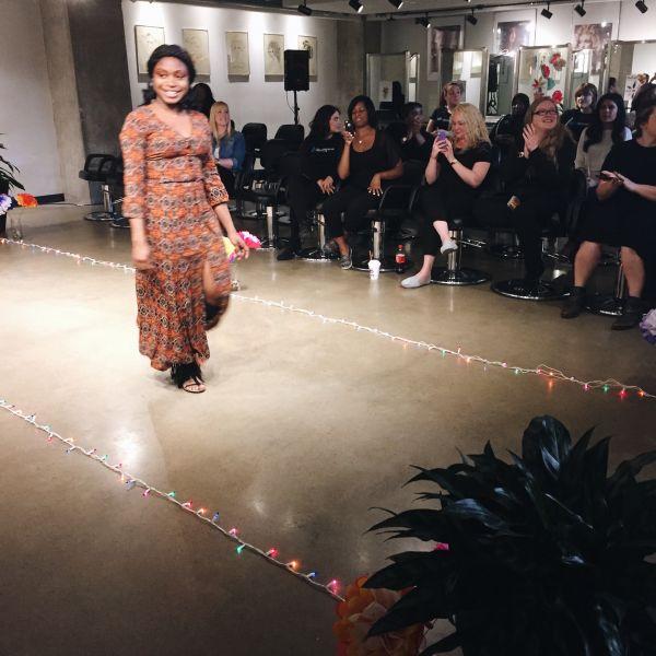 Model walking down the runway at fashion show