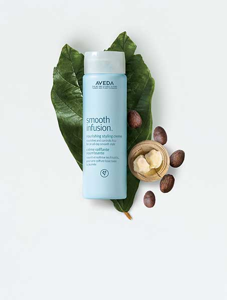 Aveda products on green leaf