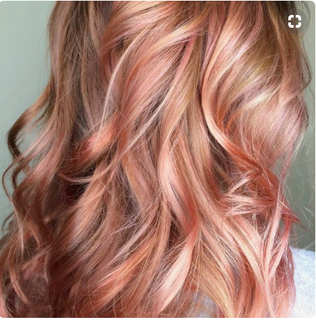 Woman with rose gold hair.